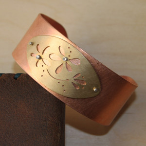 Copper and brass with silver rivets creates a fun cuff bracelet.